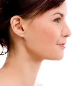 Kvinna med lent ansikte